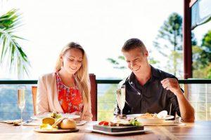 couple enjoying lunch on verandah