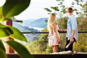 couple admiring view from verandah