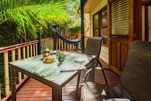 table and chair on verandah